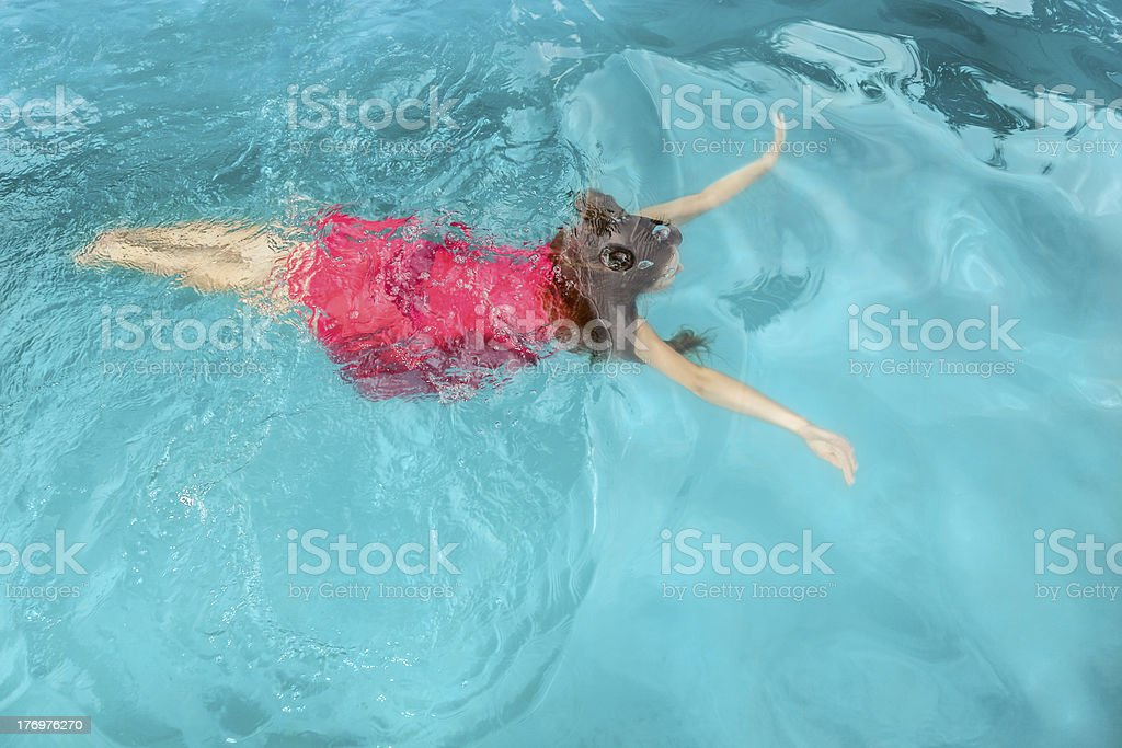 Young woman swimming under water in the pool royalty-free stock photo
