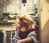 Young woman swirling her hair.