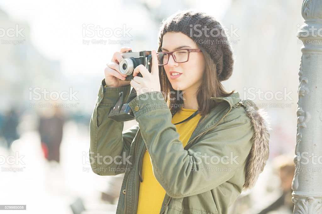 Young woman takeing a picture stock photo