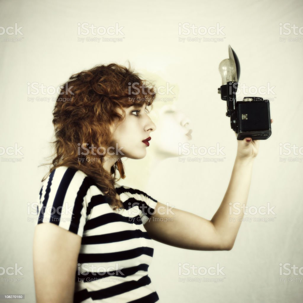 Young Woman Takes a Picture royalty-free stock photo