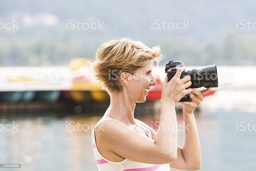 Young woman takes a picture with her DSLR royalty-free stock photo