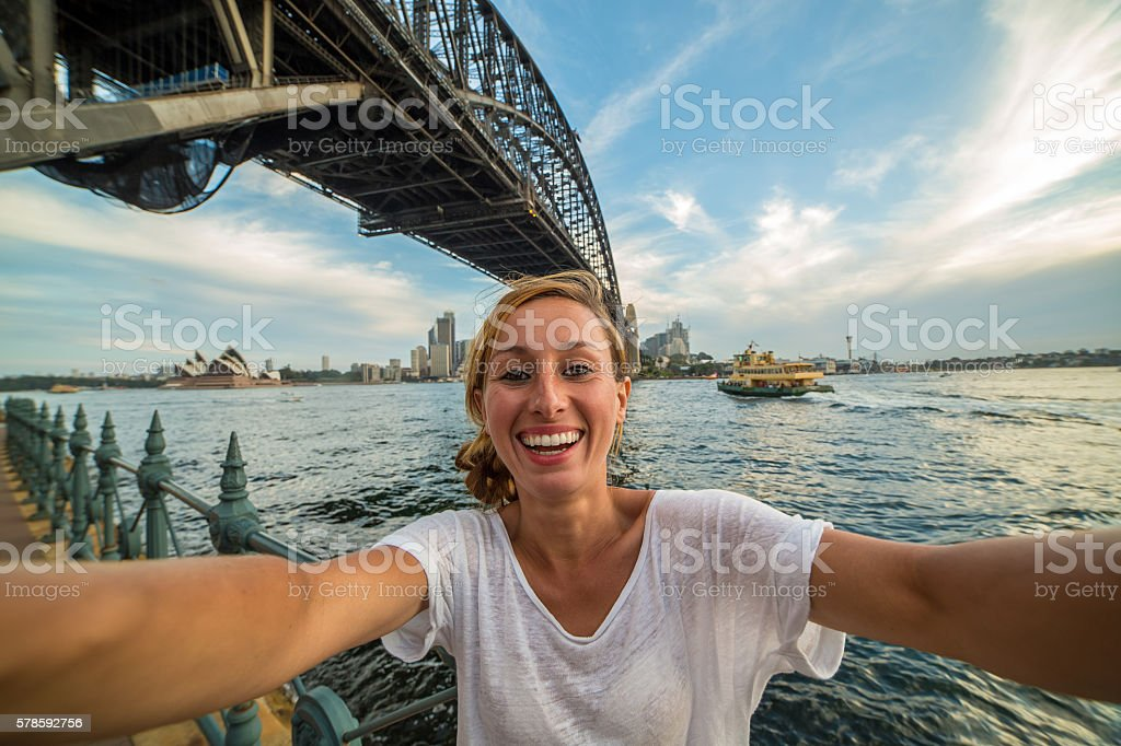 Young woman takes a selfie with Sydney skyline stock photo