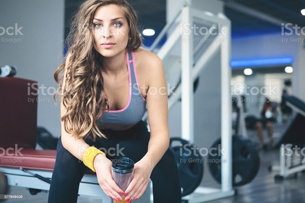 Young woman taking a break at the gym stock photo