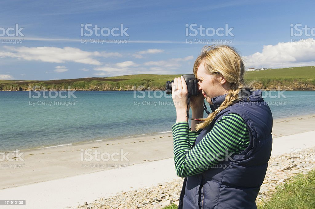 Young woman taking a photograph royalty-free stock photo