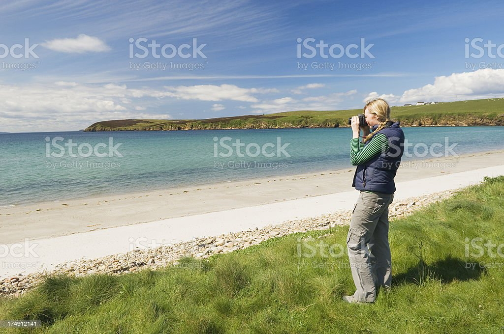 Young woman taking a photograph stock photo