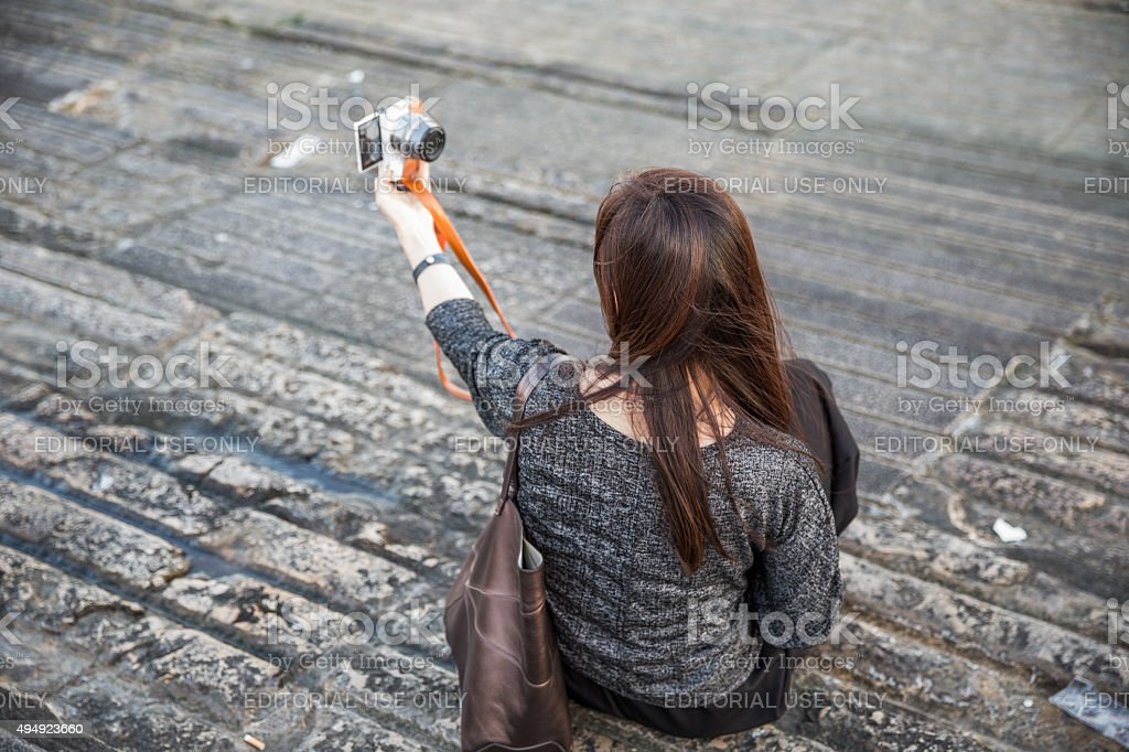 Young woman taking a selfie, Lisbon, Portugal stock photo