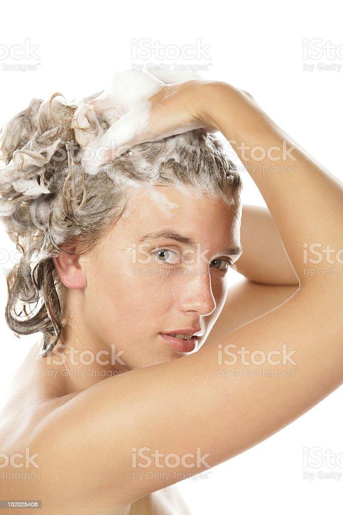 Young woman taking bath stock photo