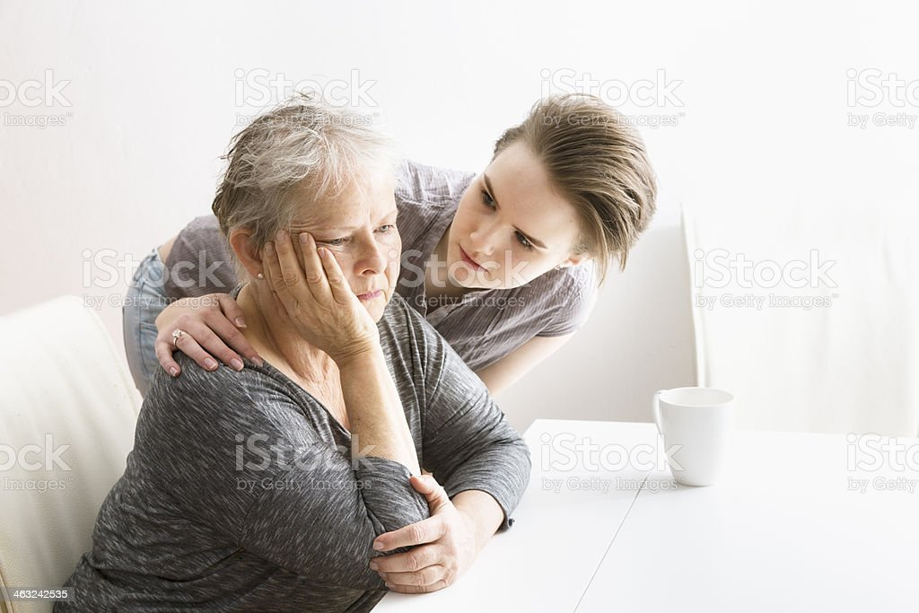 young woman taking care of senior adult stock photo