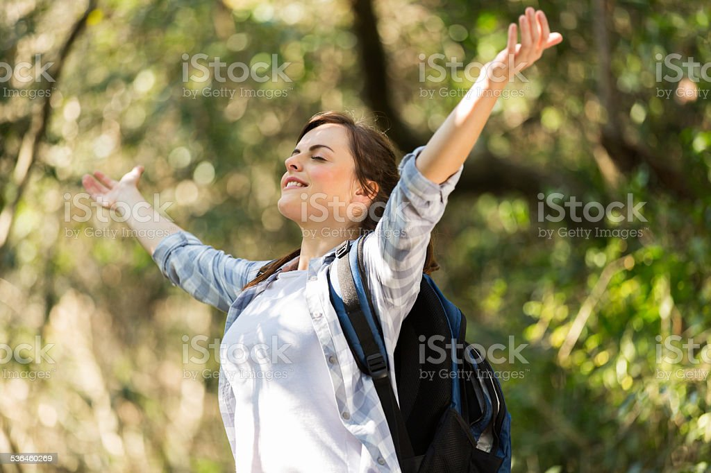young woman taking deep breath in jungle stock photo