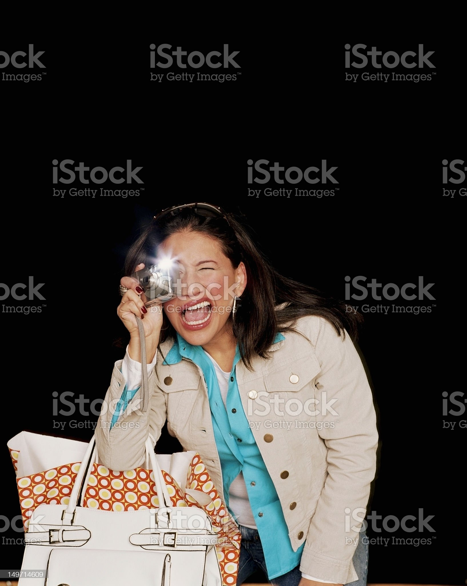 Young woman taking flash photo royalty-free stock photo