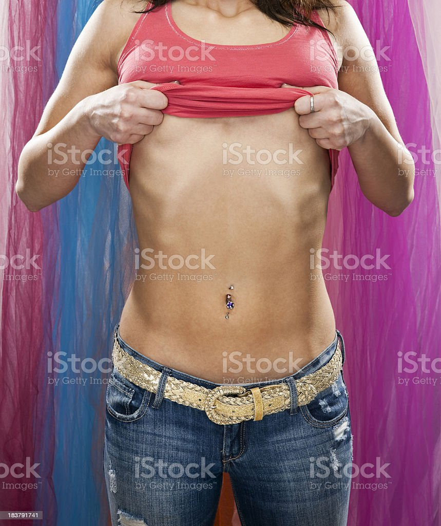 Young Woman Taking Off Shirt royalty-free stock photo
