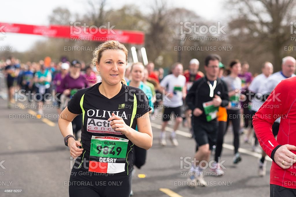 Young woman taking part in 10k marathon royalty-free stock photo
