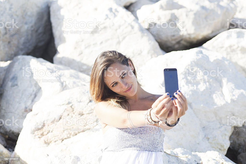 Young woman taking photo royalty-free stock photo