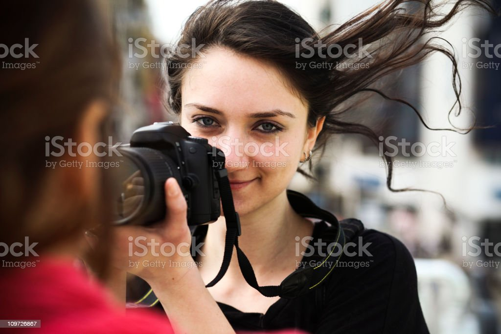 Young Woman Taking Photograph royalty-free stock photo