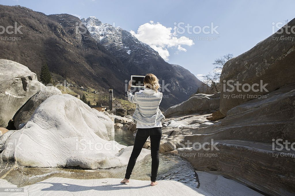 Young woman taking picture with digital tablet royalty-free stock photo