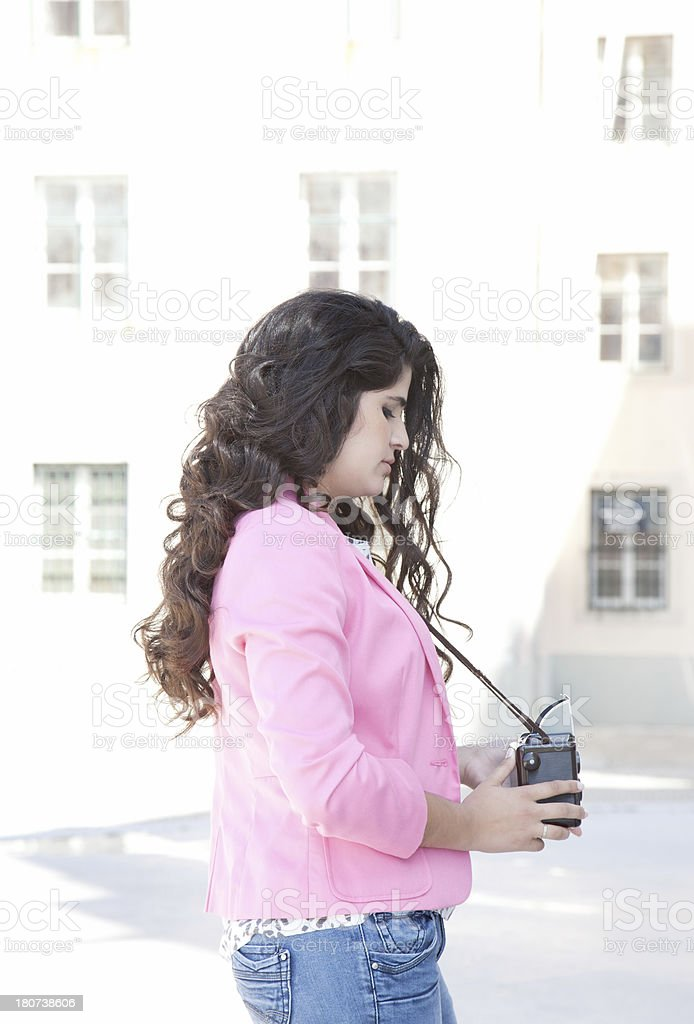 Young woman taking picture with vintage camera stock photo