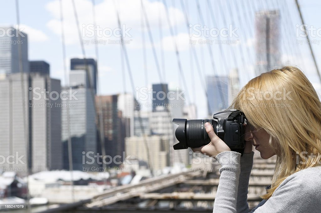 Young Woman Taking Picture,NYC. royalty-free stock photo