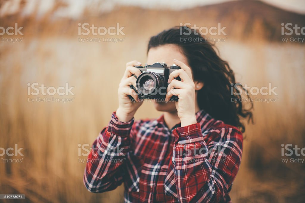young woman taking pictures stock photo