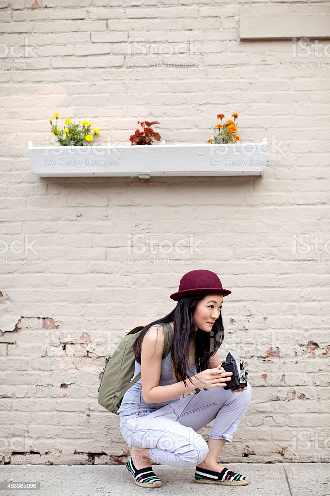 Young Woman Taking Pictures With Vintage Camera In Brooklyn stock photo