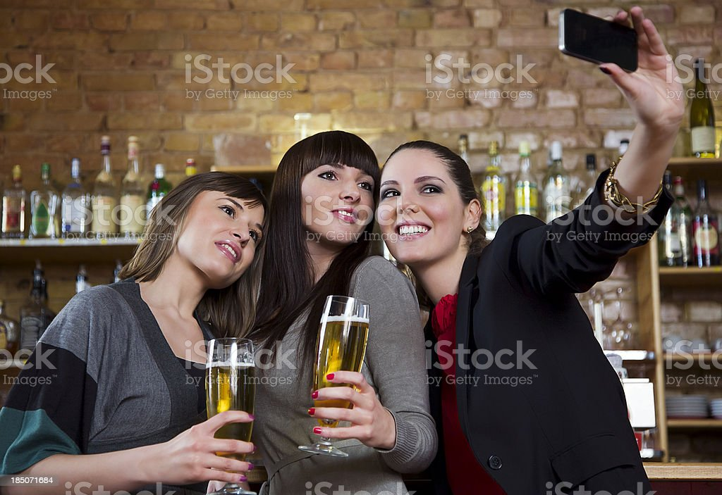 Young Woman Taking Self Portrait with Smartphone royalty-free stock photo