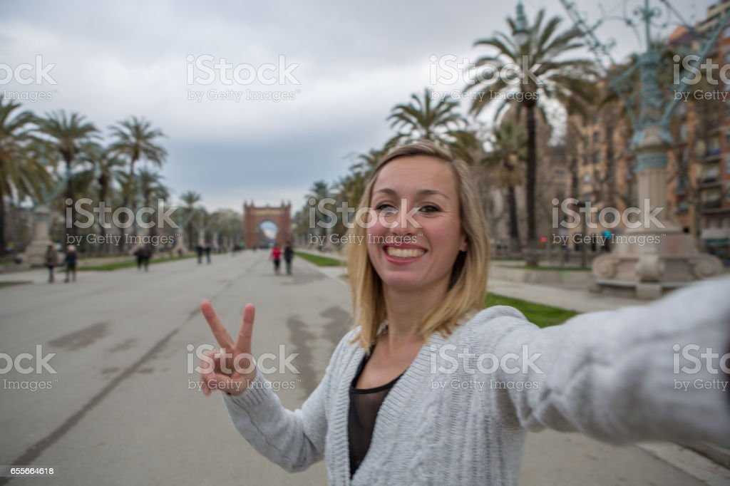Young woman taking selfie at Arc de Triomf,Barcelona stock photo