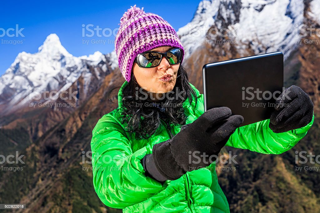 Young woman taking selfie in Himalayas, Mount Everest National Park stock photo