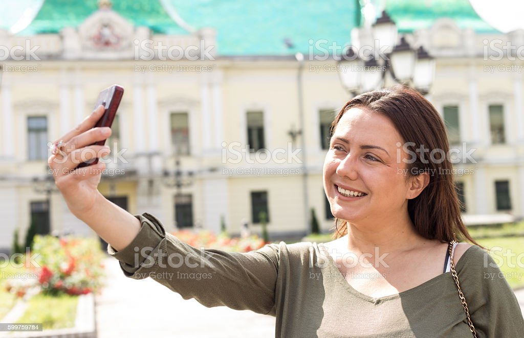 young woman  taking selfie photo stock photo