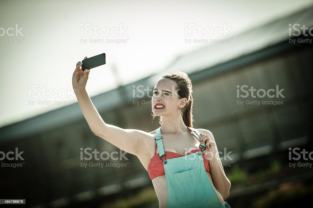 Young Woman Taking Selfie stock photo
