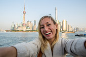 Young woman taking selfie portrait in Shanghai, China