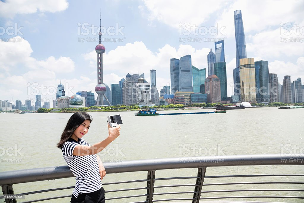 Young woman taking selfie while standing stock photo
