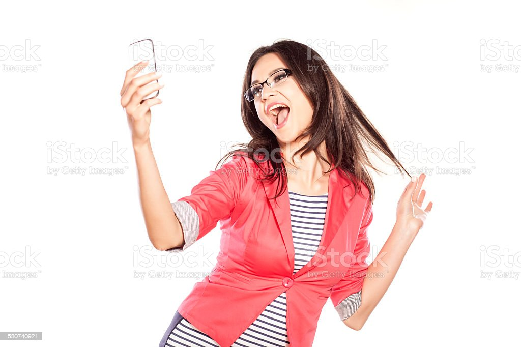 Young woman taking selfportrait stock photo