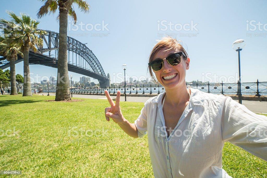 Young woman tales selfie portrait with Sydney harbour bridge stock photo