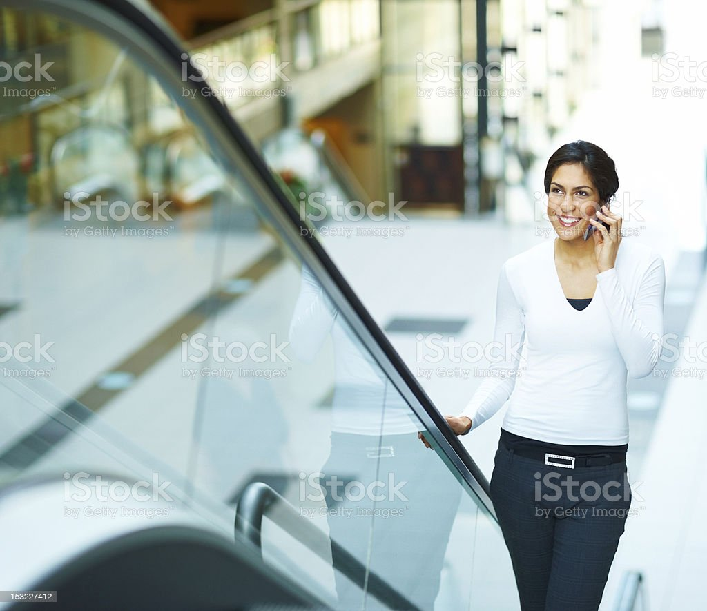 Young woman talking on cellphone royalty-free stock photo