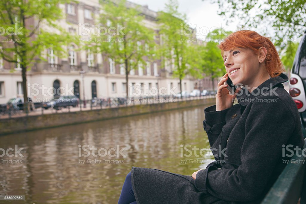 Young woman talking on cellphone stock photo