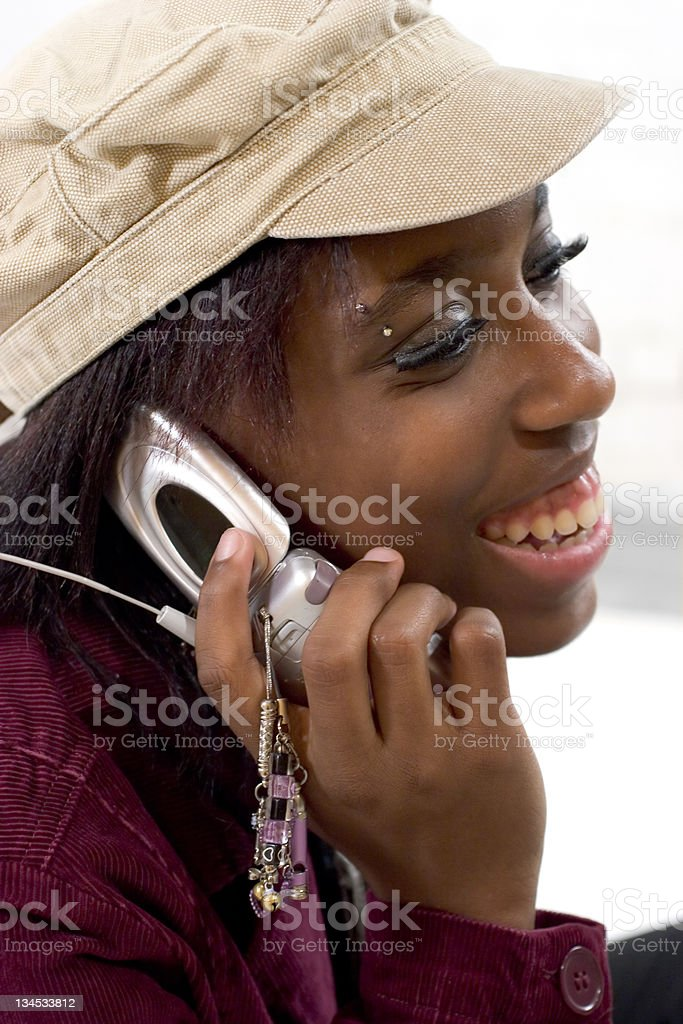 Young woman talking on her cellphone stock photo