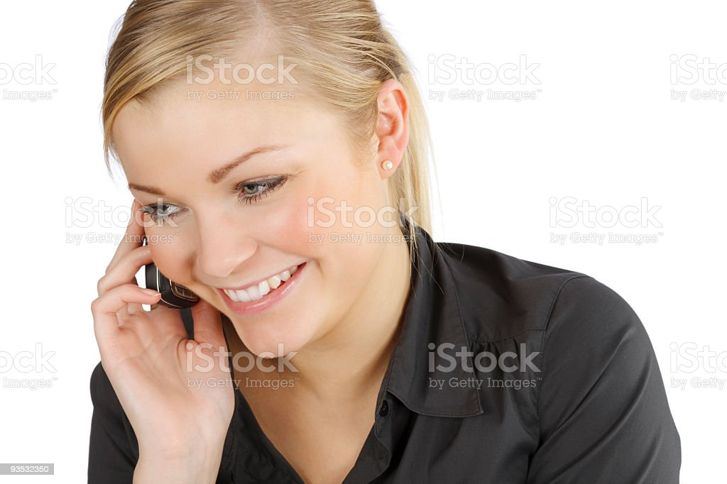 Attractive young blond woman talking on her cellphone stock photo