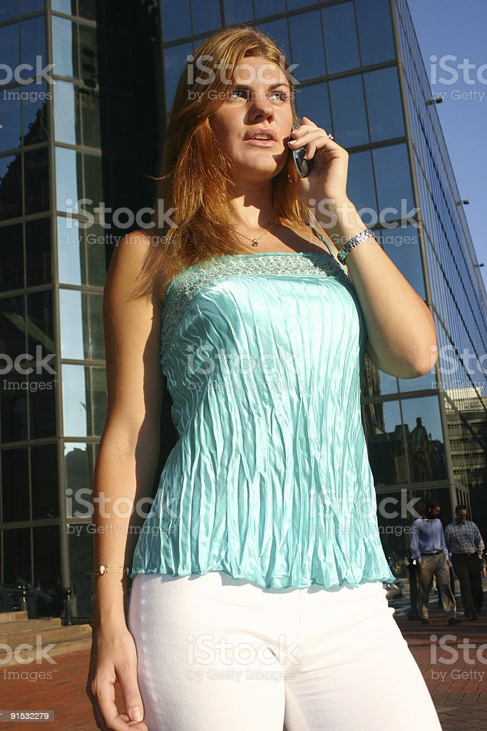 Young Woman Talking on Her Phone royalty-free stock photo