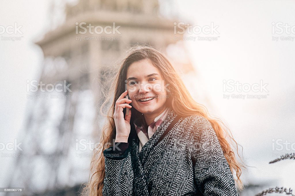 Young woman talking on the phone in Paris stock photo