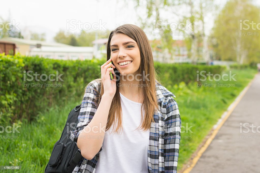 Young woman talking on the phone. No retouch. stock photo