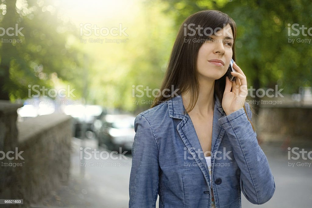 Young woman talking on the phone. stock photo