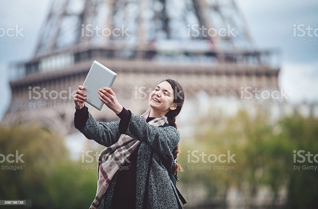 Young woman talking selfie with tablet computer stock photo
