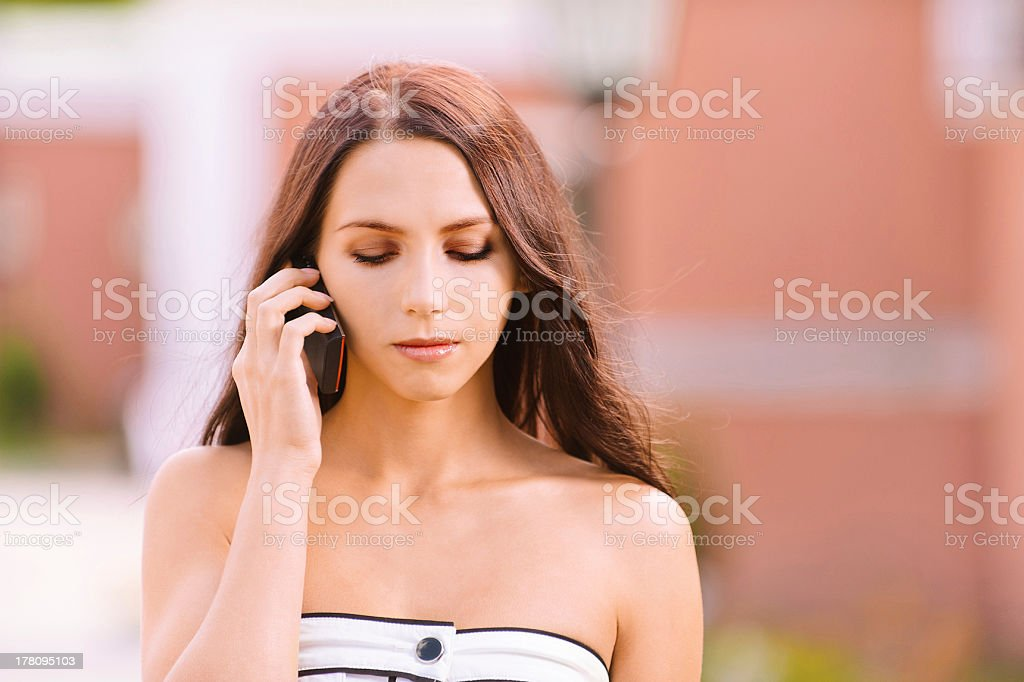 Young woman talks by mobile phone stock photo