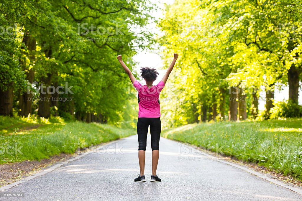 Young Woman Teenager Fitness Running Celebrating stock photo