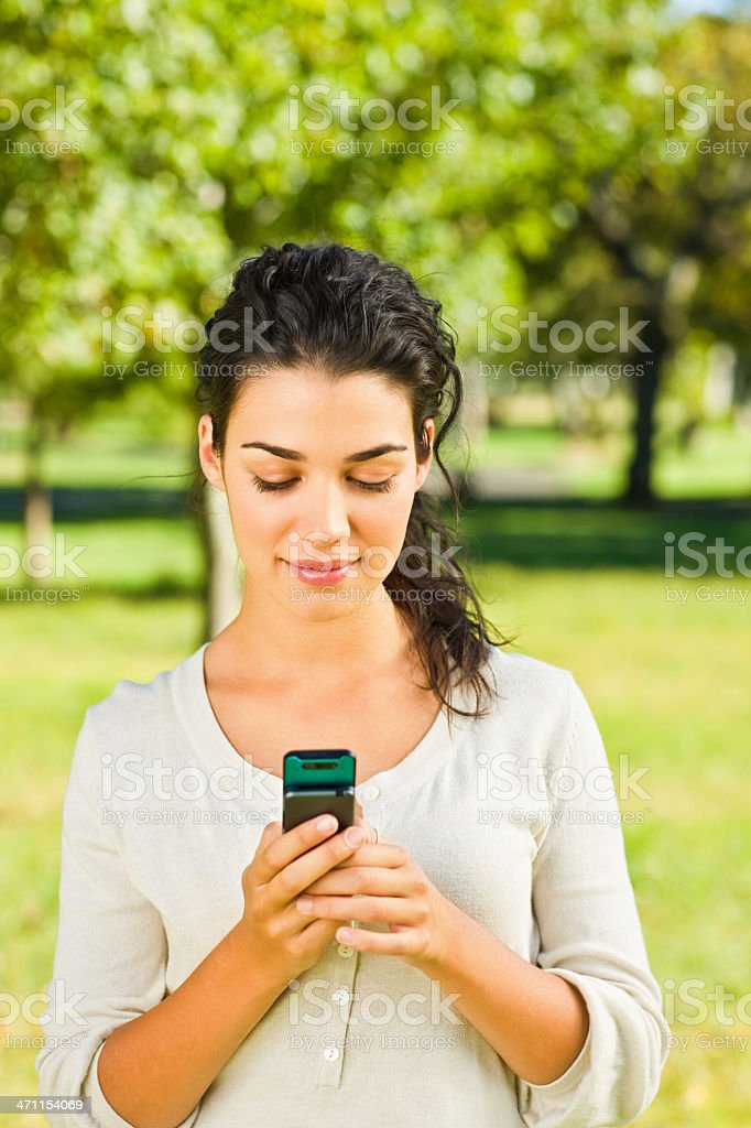 Young woman text messaging royalty-free stock photo