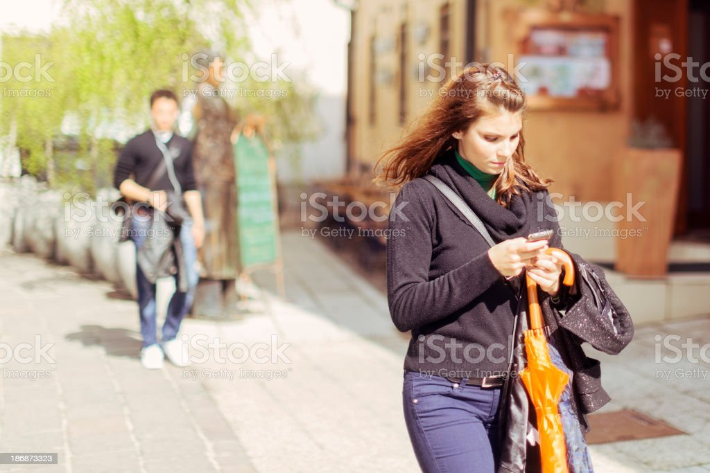 Young woman texting on her mobile phone royalty-free stock photo