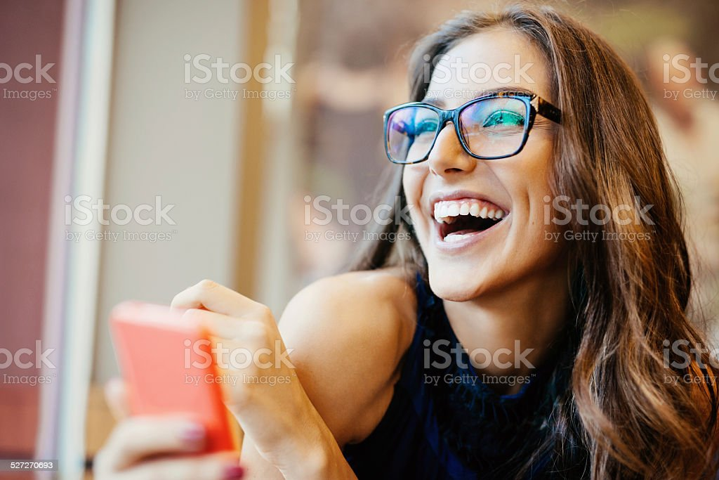 Young woman texting on smart phone stock photo