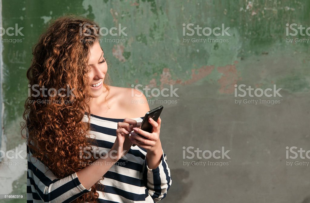 Young woman texting on smartphone stock photo