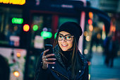 Young woman texting on the phone
