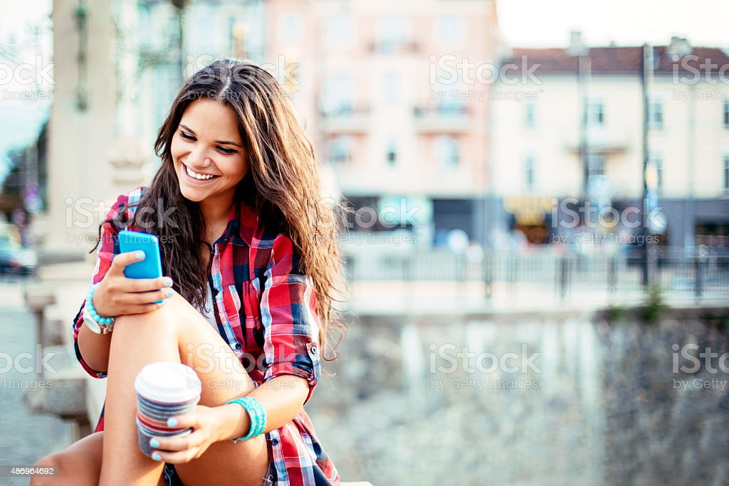 Young woman texting stock photo