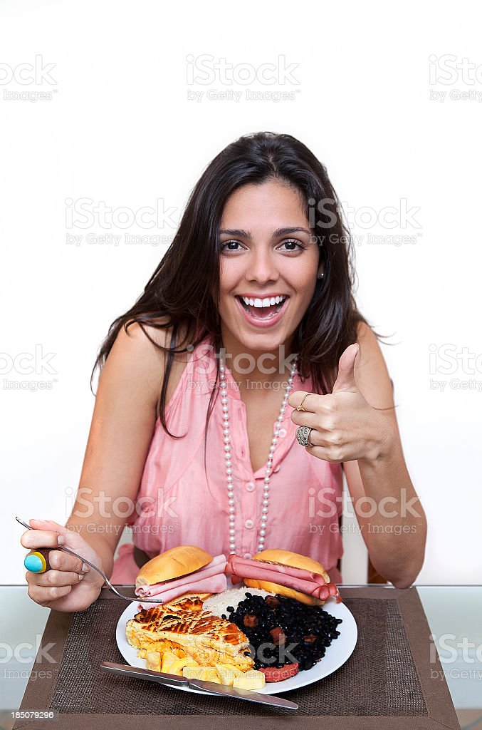Young woman that can eat everything royalty-free stock photo